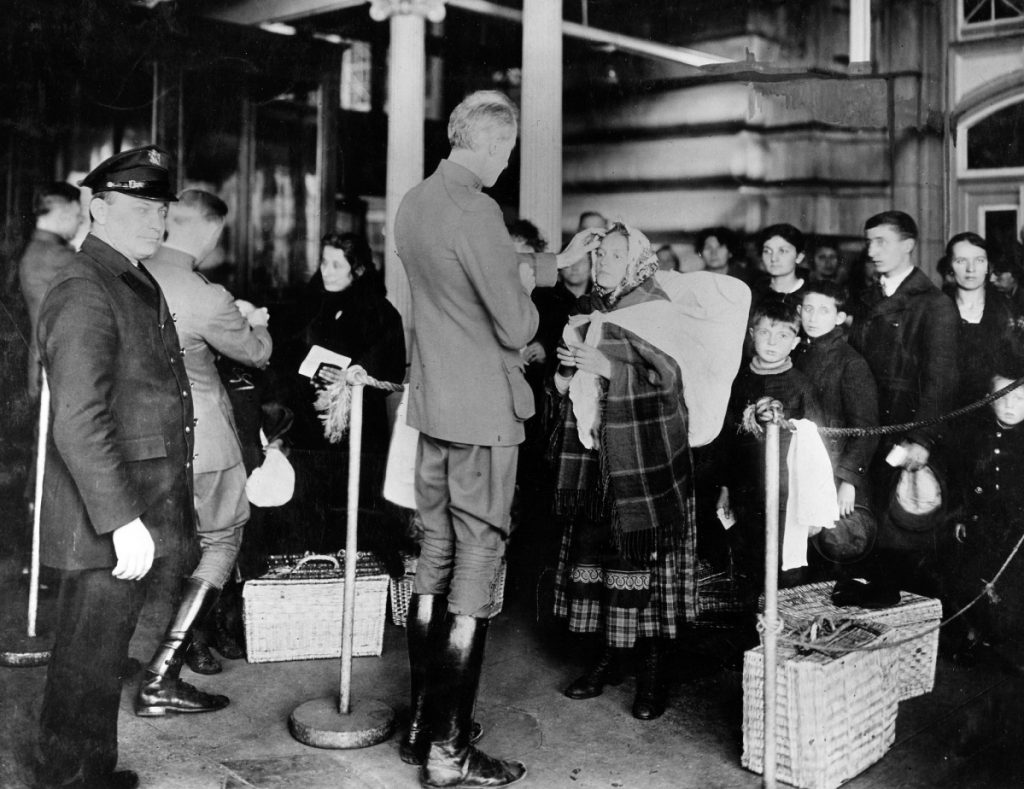 Doctors check immigrants arriving at Ellis Island for signs of illness in 1910. A recent Maine Voices calling for greater immigration limits cites the same arguments used to justify earlier quotas on immigration from southern and eastern Europe, a reader says.