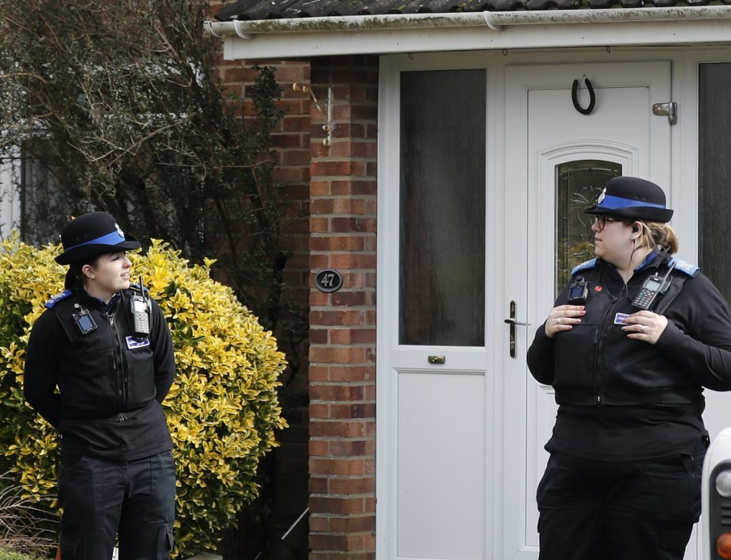 Police stand guard outside the home of former Russian spy Sergei Skripal.