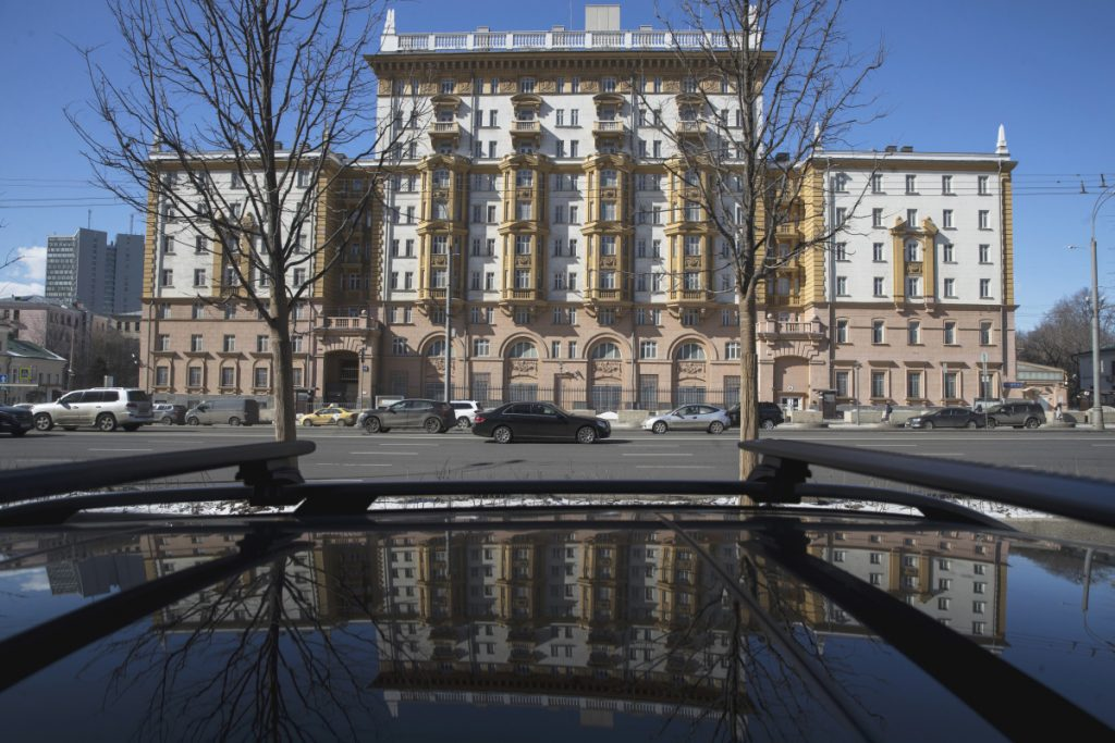 The U.S. Embassy is reflected in a car in Moscow, Russia, on Thursday. Russia is kicking out U.S. diplomats in response to Monday's coordinated expulsion of Russian diplomats from the United States and a number of European countries, Foreign Minister Sergei Lavrov said Thursday.