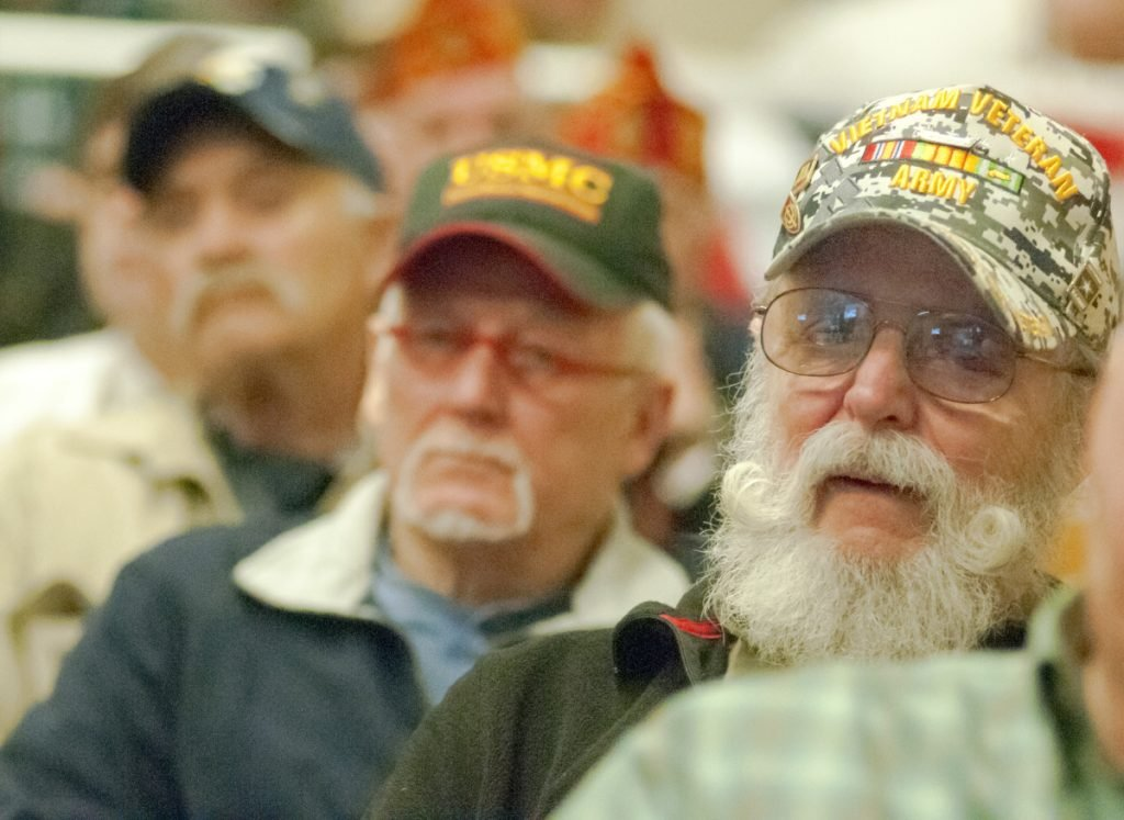Vietnam War veterans Charlie Smith, of Cushing, center, and Albert Kontrath, of Wiscasset, listen to speeches Thursday during a Vietnam War 50th anniversary event at the VA Maine Healthcare Systems-Togus, which includes the federal hospital outside Augusta.