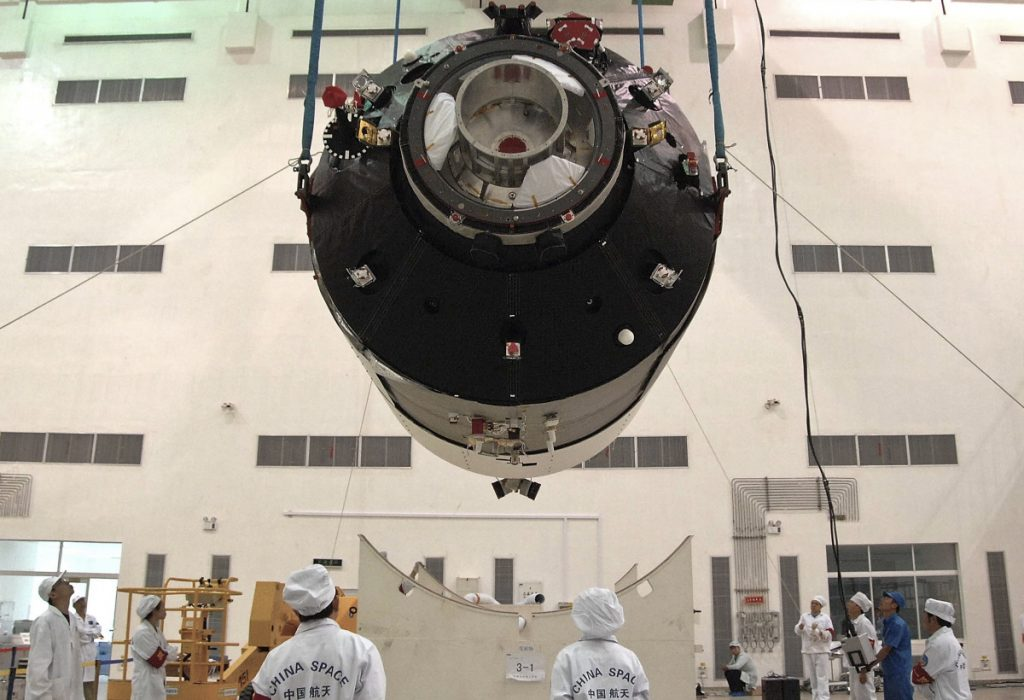 Researchers install China's first space station module Tiangong 1 at the Jiuquan Satellite Launch Center in China's Gansu Province prior to its launch on Sept. 29, 2011.