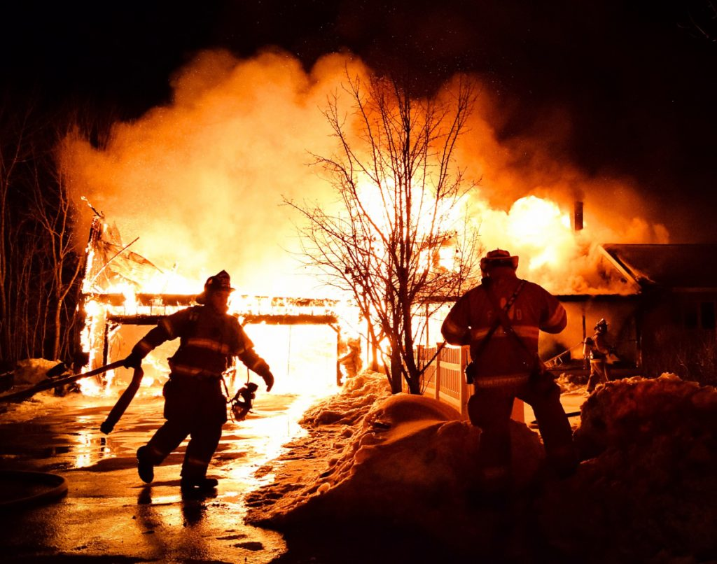 Firefighters from Greene, Monmouth, Wales and other towns work on March 19 at the scene of a house fire on Patten Road in Greene, one of three that occurred in the Androscoggin County town in March. From left are Wales firefighter Garrett Gile and Wales Fire Chief Anthony Siderio Sr.