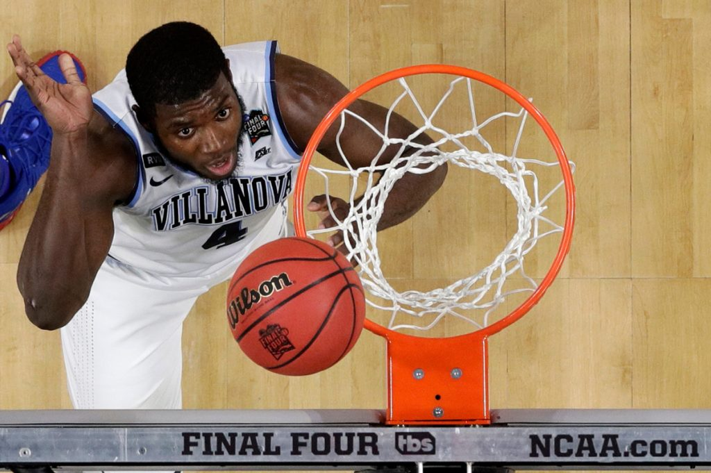 Villanova forward Eric Paschall scores during the second half  of his team's win over Kansas in the semifinals of the Final Four in San Antonio.