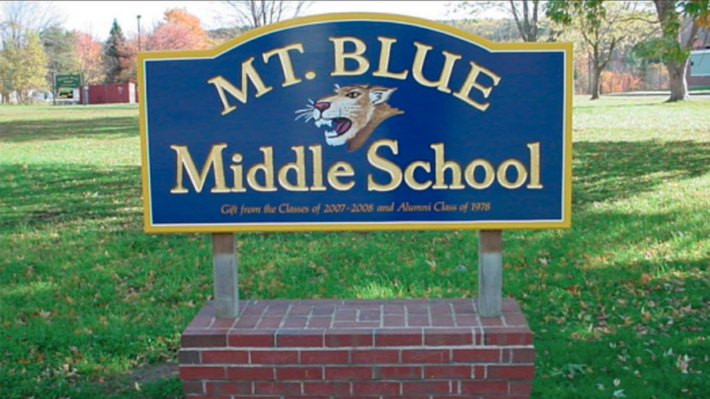 Two Mt. Blue Middle School students were summoned on a charge of terrorizing and suspended from school for five days.