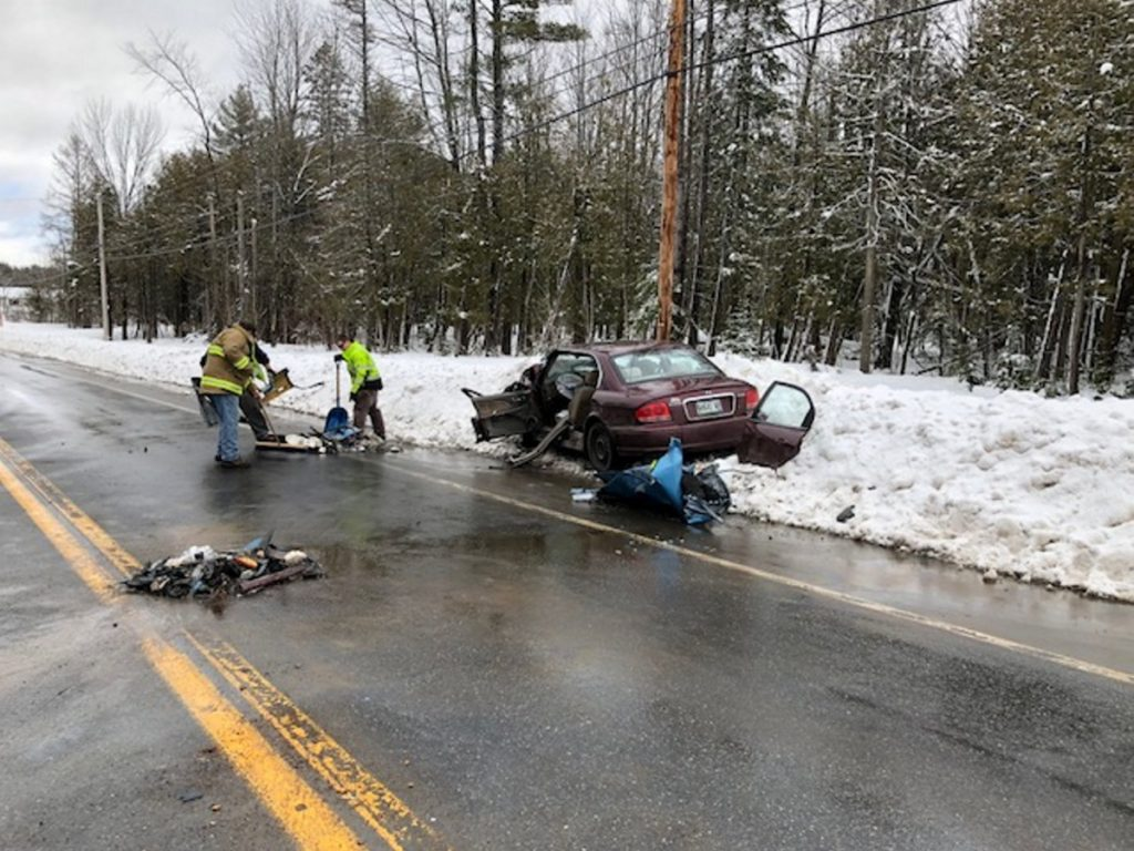 Debris from a two-car head-on collision on U.S. Route 2 in Canaan near the intersection with Tropical Fish Road is cleaned up. The two drivers and a passenger were all taken to hospitals to be treated for injuries that apparently were not life-threatening.