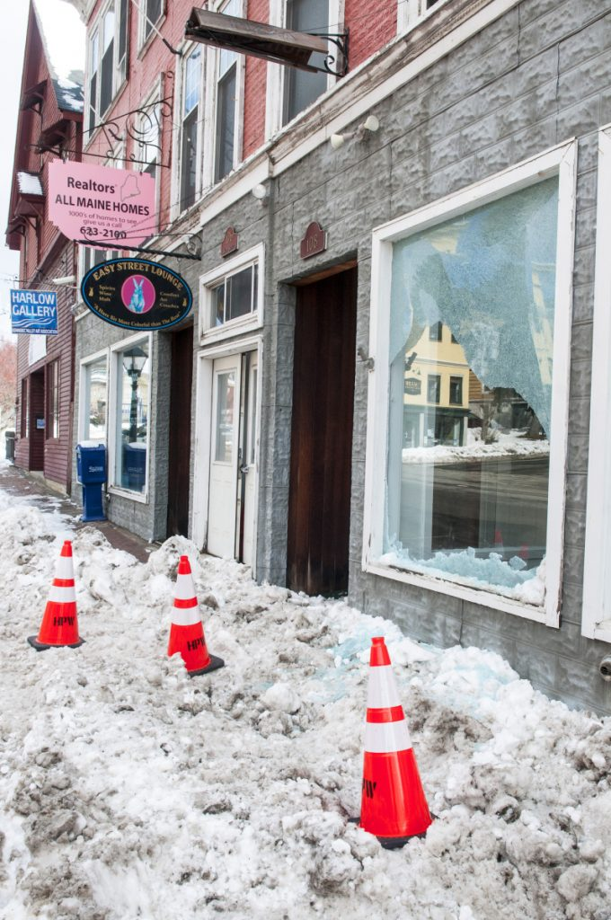 Damage to the window of unoccupied store front at 106 Water St. is seen Thursday in downtown Hallowell. Earlier in the morning, a hit-and-run driver of a tractor trailer failed to stop at intersection of Water and Winthrop Streets then struck a street light, which broke the window.
