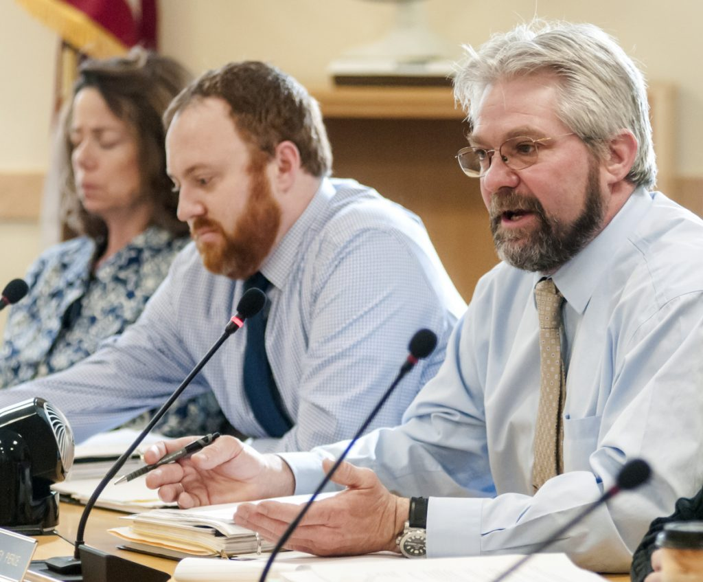 Rep. Jeffery Pierce, R-Dresden, right, asks a question during a meeting of the Government Oversight Committee on Friday in the Cross State Office Building in Augusta. Pierce voted against having the Department of Labor and its unemployment filing system investigated.