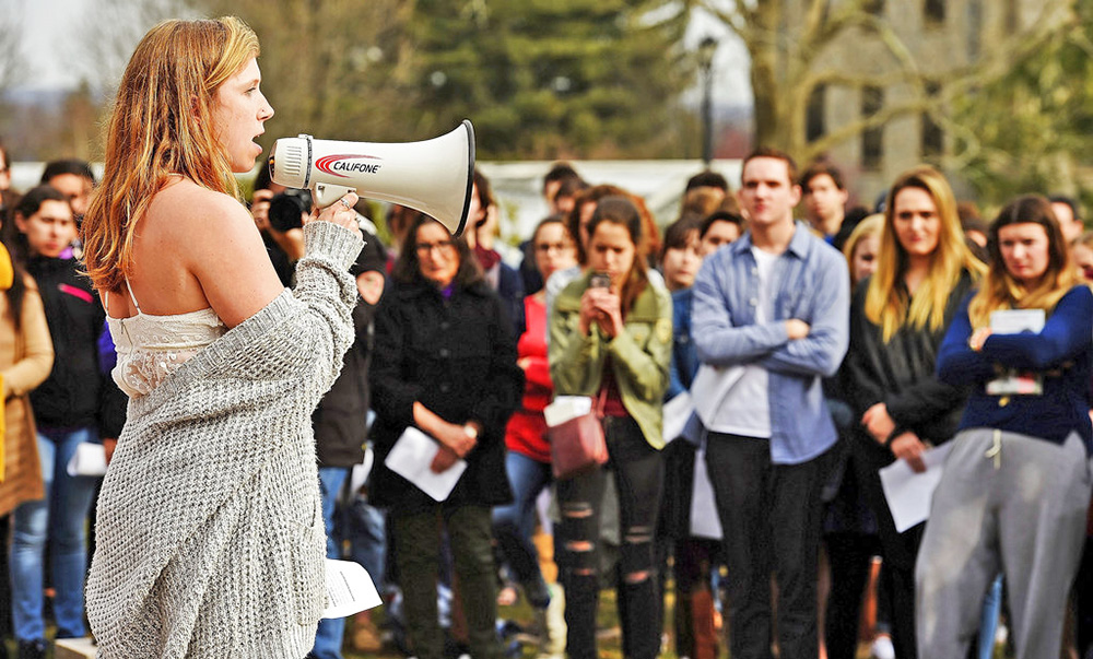 Alison Joyce takes her turn at the megaphone as students at Connecticut College in New London, Conn., rally against gun violence Thursday. A nationwide student walkout to protest gun violence is planned for March 14.