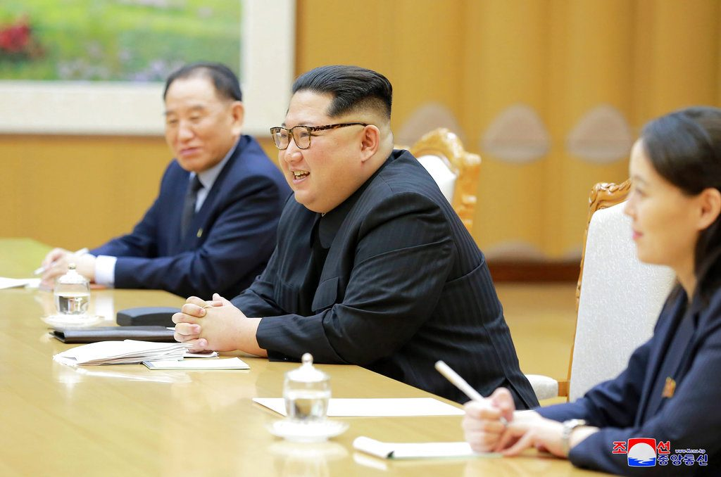 North Korean leader Kim Jong Un, center, his sister Kim Yo Jong, and Vice Chairman of North Korea's ruling Workers' Party Central Committee Kim Yong Chol meet members of a South Korean delegation headed by National Security Director Chung Eui-yong in Pyongyang, North Korea, on Monday. Service via AP)