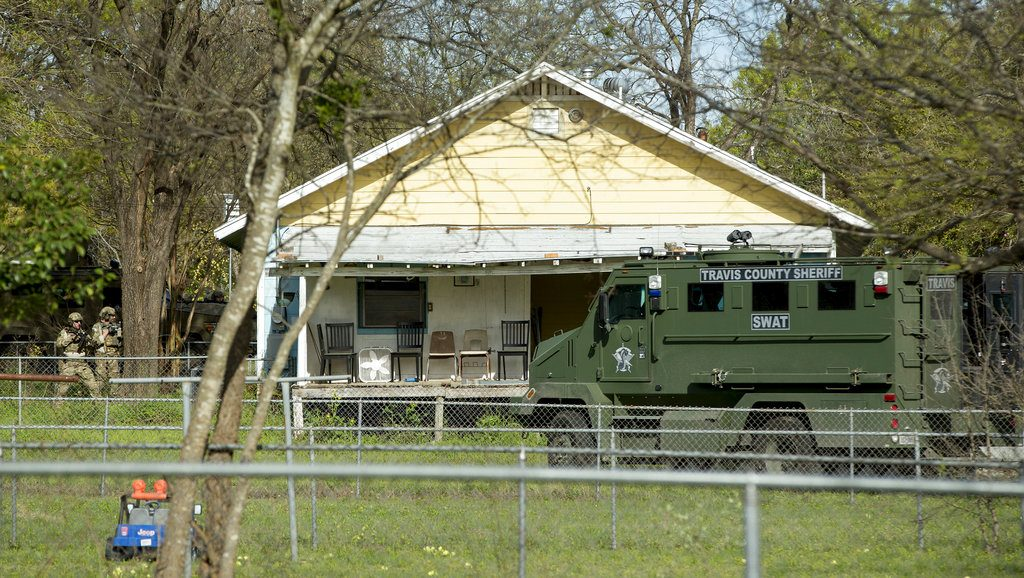 Authorities surround the home of the Austin bombing suspect Mark Conditt in Pflugerville, Texas, Wednesday.