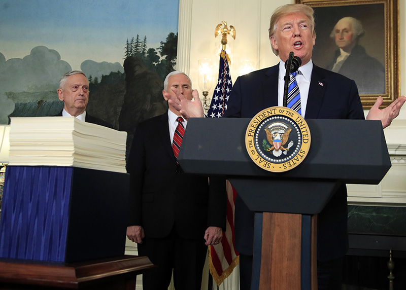 President Donald Trump with, Defense Secretary Jim Mattis, left, and Vice President Mike Pence, speaking at the White House on Friday.