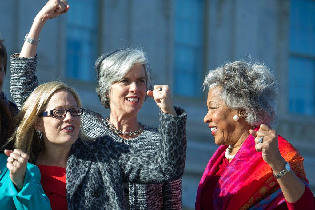 From left, Rep. Kyrsten Sinema, D-Ariz., Rep. Katherine Clark, D-Mass., and Rep. Joyce Beatty, D-Ohio, shown in January 2017, raise fists to show unity on Capitol Hill in Washington. Sinema is running for the Senate.