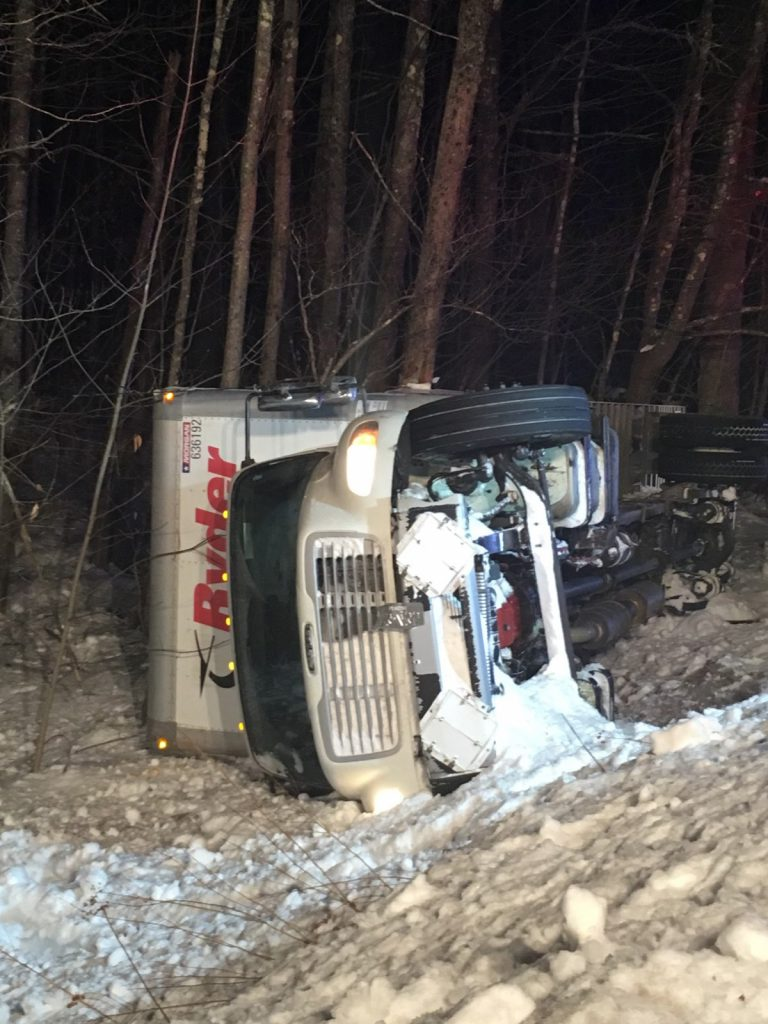 A truck carrying Amazon packages rolled over in Limington early Monday morning, spilling fuel and transmission fluid on Sokokis Trail.