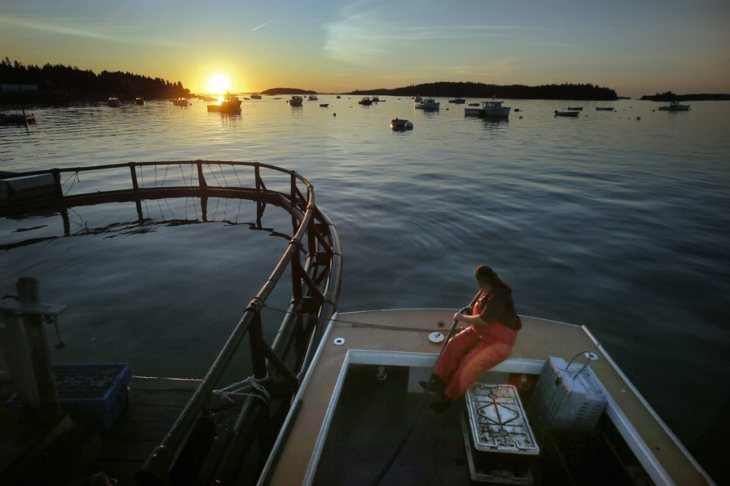 Genevieve McDonald fills up her lobster boat with gas before heading out for a day of lobstering off the coast of Stonington. The best lobstering used to be in Casco Bay in the 1980s but has shifted east and is now considered to be in and around Stonington.