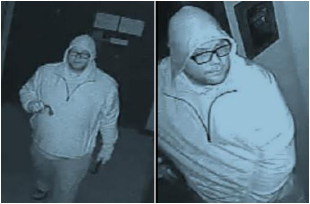 The suspect is described as a heavyset white man wearing dark-rimmed glasses. He was dressed in dark clothing, including gloves. His sweatshirt appears light in security video images because of the night-vision aspect of the cameras.