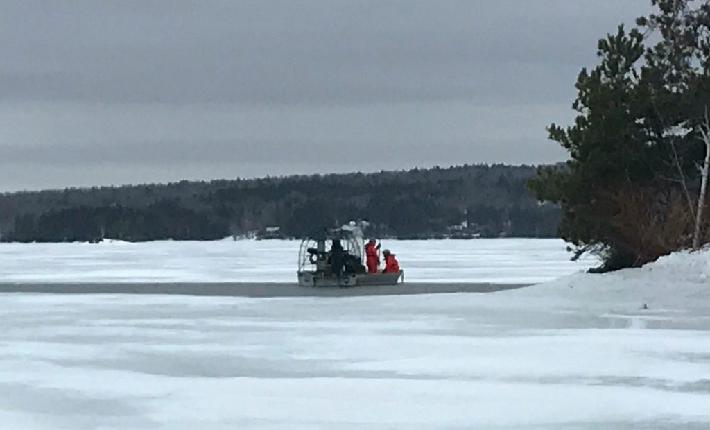 Game wardens use a Maine Warden Service airboat as they work to recover the body of Matthew Dubien from Moosehead Lake on Wednesday.