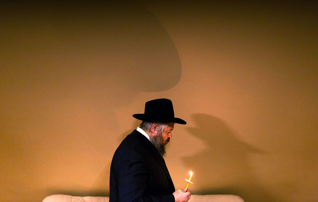 Rabbi Moshe Wilansky leads the search of his house for chametz on the night before Passover begins, March, 2018.  The ritual is meant to clean the house of any chametz, or leavened goods, before the start of Passover, because leavened items are not allowed during the holiday. The children hide crumbs of bread through out the house and the bag of bread crumbs is burned the following morning.