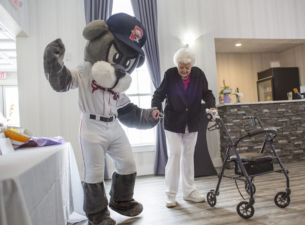 Slugger and Betty Stetson dance during her 100th birthday party in Windham. The Red Sox sent a letter thanking her for her support. The Red Sox won three World Series titles during her lifetime; the first was the 1918 series when Babe Ruth led the team to the championship.