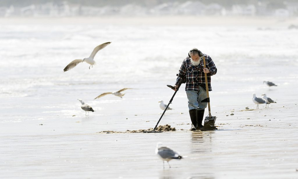 Bob Daigle of Biddeford searches for treasures along the beach in Old Orchard Beach March 27, 2018. Old coins, rings and other jewelry items are among some of the items he says he might find.