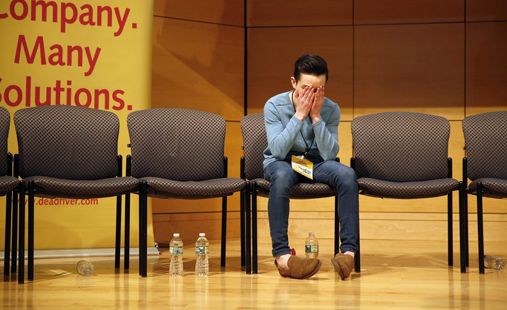 """Colin Aponte, an eighth-grader at Downeast Homeschool Coop, reacts as his final opponent, Moriah Reusch, a seventh-grader from Mt. Blue Middle School, misspells a word. Aponte won the Maine State Spelling Bee in the next turn by properly spelling """"crescendo."""" Champions from 14 Maine counties competed for the chance to represent the state at the Scripp's National Spelling Bee in Washington, D.C."""