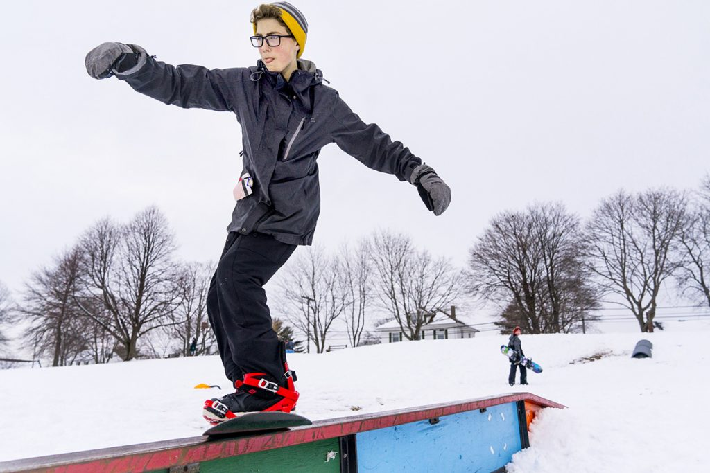 Harrison Fream, 14, of Scarborough, grinds on a rail at Payson Park in Portland as he snowboards with his twin brother, Gordon, after school on March 9.