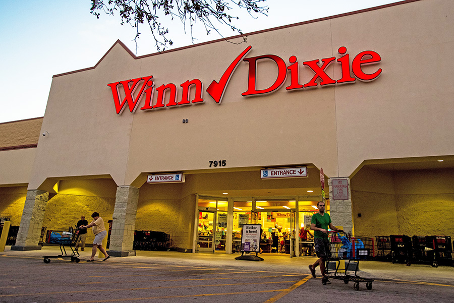 Shoppers exit a Winn-Dixie Store supermarket in Palm Beach, Florida, recently. Southeastern, which owns more than 600 Winn-Dixie, Harvey's and BI-LO stores across seven states in the Southeast, announced a refinancing agreement on March 15 and says it will file for bankruptcy by April.