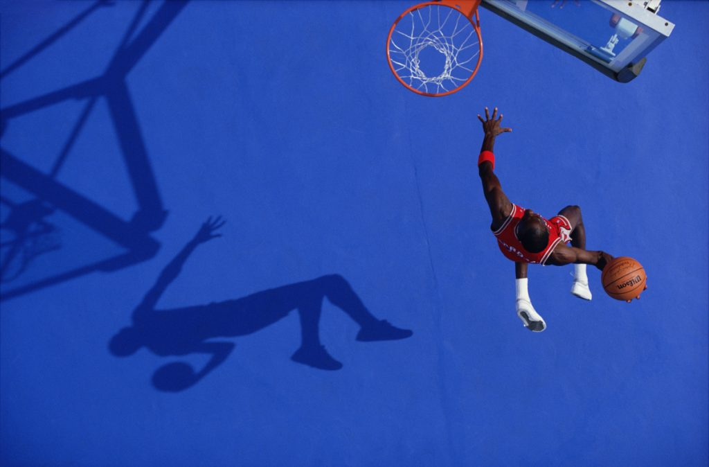 """Blue Dunk"" (Michael Jordan), 1987 (printed later), archival pigment print, 20 by 24 inches."