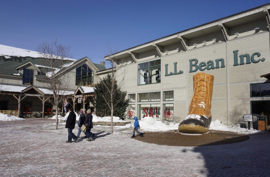 "People walk through a plaza at an entrance to the L.L. Bean flagship store in Freeport last winter. Massachusetts customers of L.L. Bean won't have to drive to Maine to buy duck boots and brushed fleece pullovers. The New England outdoor retailer is opening its first urban retail store in Boston on April 6. The 8,600-square-foot store at One Seaport will sell casual and active apparel, footwear and outdoor gear. Doors will open at 9 a.m., and the first 100 customers in line will receive a store gift card worth up to $500. Red Sox legends Jim Rice and Luis Tiant will be at the event, which coincides with Red Sox opening weekend. The Maine-based company is excited to have its first city store in Boston, citing the ""outdoor spirit"" of Bostonians as one of its reasons for choosing the location. L.L. Bean's sales dipped slightly over the past year, prompting the retailer to cut close to 100 jobs and forcing the elimination of worker bonuses for the first time since 2008."