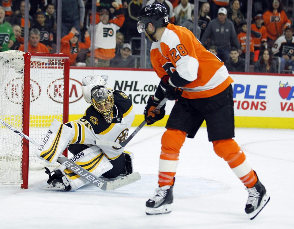 Philadelphia's Claude Giroux, right, beats Bruins goalie Anton Khudobin for the winning goal in overtime Sunday in Philadelphia. The Flyers won 4-3.