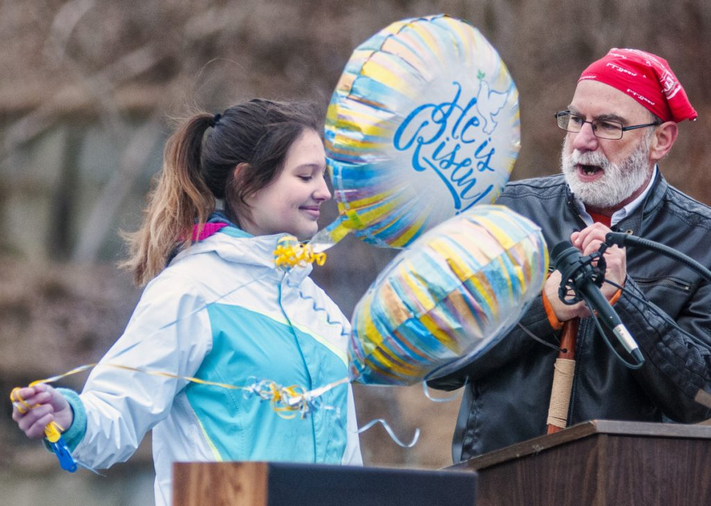 "Shantel Walsh and the Rev. Ted Chaffee present a skit, ""Good Question – Great Answer,"" about the grammatical and religious stories behind the phrase ""He is risen"" during an Easter sunrise service in Gardiner's Waterfront Park."