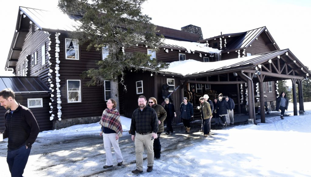 Unity College administrators and staff leave the Sky Lodge in Moose River last week to tour the property that was given to the college by John and Elaine Couri.
