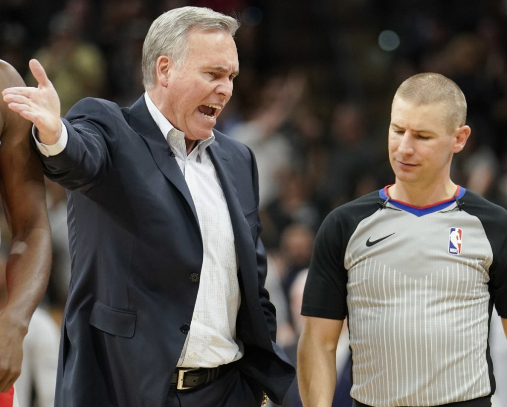 Houston Coach Mike D'Antoni argues with referee Tyler Ford during the first half of a 100-83 loss Sunday to the San Antonio Spurs. It was Houston's lowest-scoring game of the season.