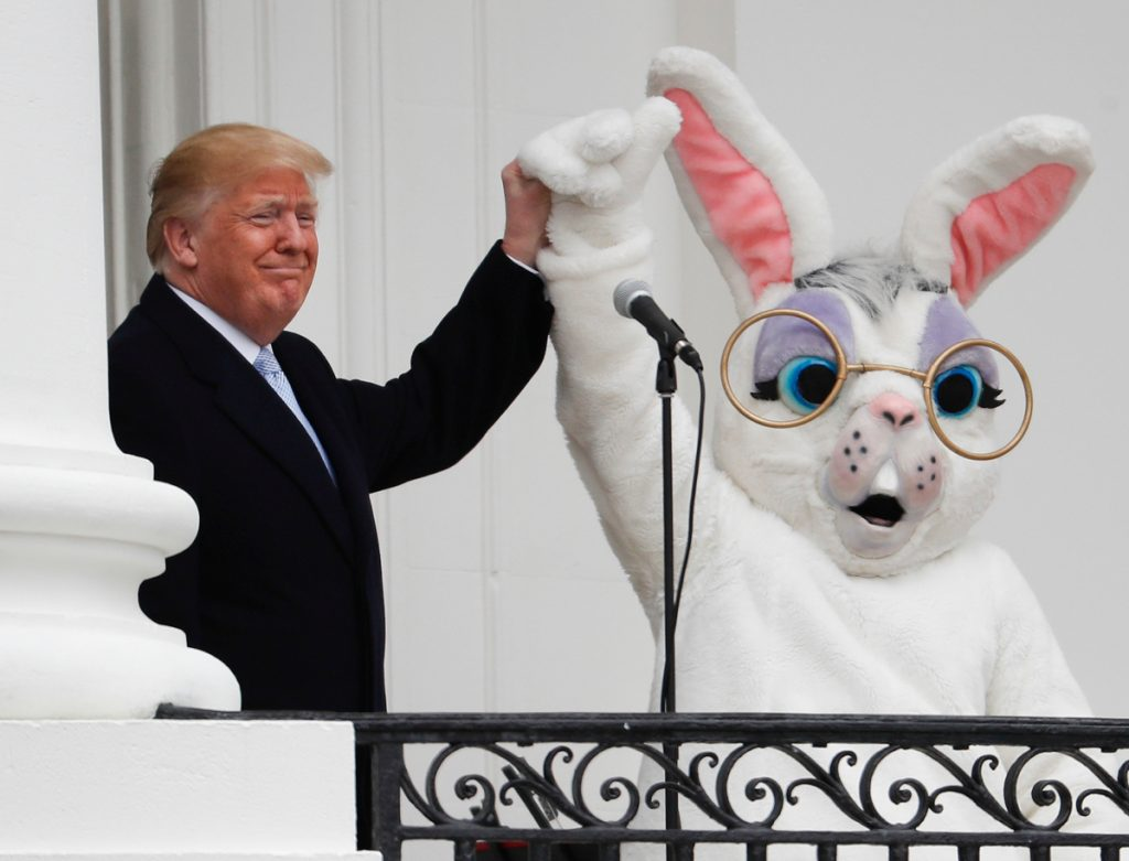 President Trump joins the Easter Bunny after speaking to the crowd on the Truman Balcony during the annual White House Easter Egg Roll on the South Lawn on Monday.