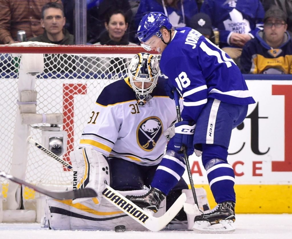 Buffalo Sabres goalie Chad Johnson makes a save against Andreas Johnsson of the Maple Leafs during Toronto's 5-2 win Monday night.