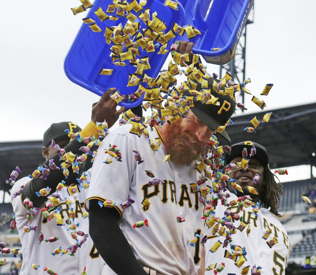 Colin Moran gets a bubble gum shower from Pittsburgh teammates Gregory Polanco, left, and Josh Bell following the Pirates' 5-4 win Monday against the Twins.