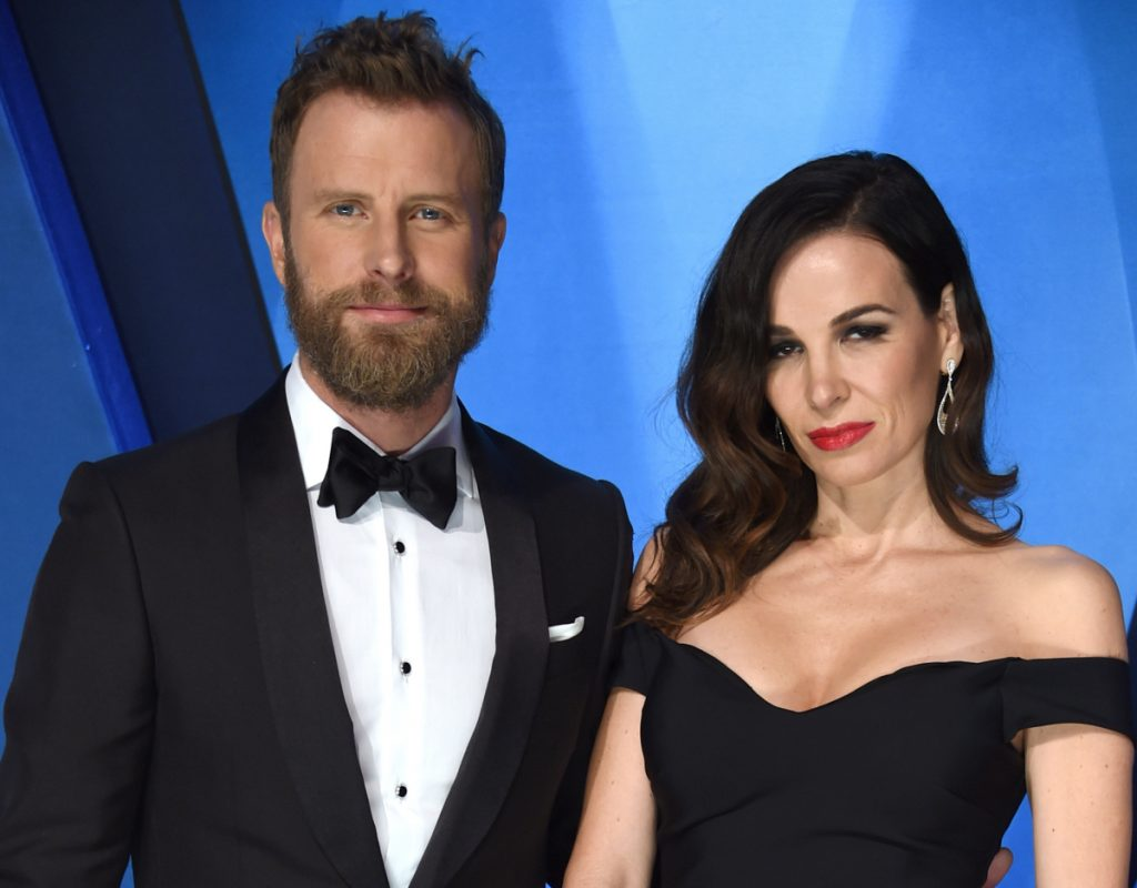 "Dierks Bentley, left, and his wife Cassidy Black arrive at the 51st annual CMA Awards in Nashville, Tenn, last year. Bentley said he hopes ""Woman, Amen,"" will counter some of his other work."