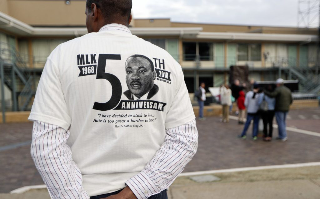A man wears a shirt commemorating the 50th anniversary of the death of The Rev. Martin Luther King Jr. outside the National Civil Rights Museum on Monday. King was assassinated April 4, 1968.