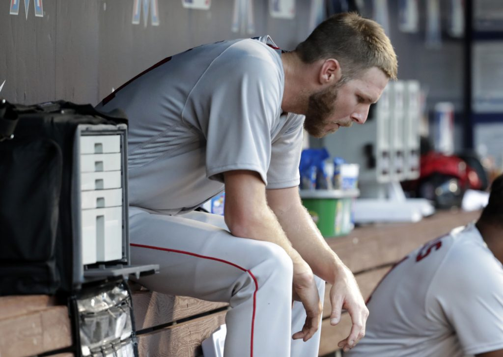 Red Sox starting pitcher Chris Sale sits in the dugout after the end of his outing Tuesday in Miami. Boston won 4-2 in 13 innings, leaving Sale without a decision despite allowing just one run in 11 innings over two starts so far this season.
