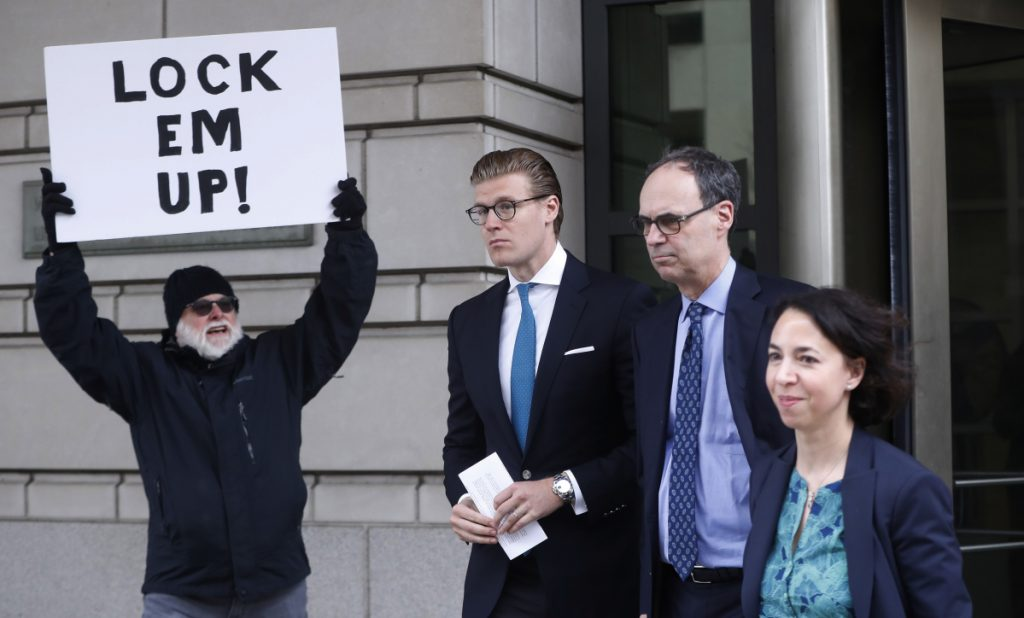 Alex van der Zwaan, center, leaves Federal District Court in Washington on Tuesday.