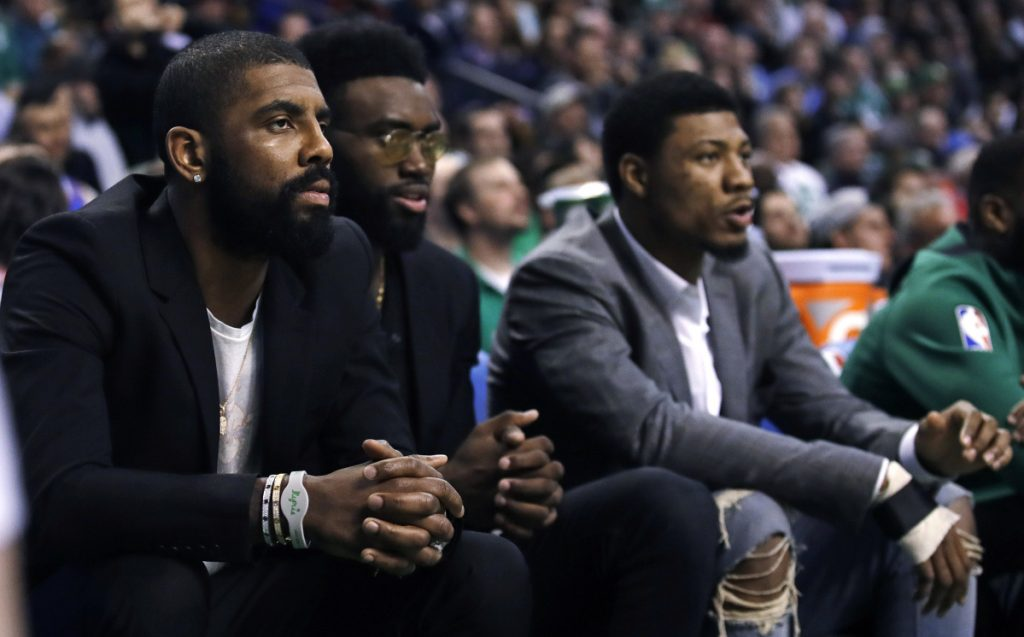 Boston Celtics guard Kyrie Irving, left, will miss the rest of the season. He faces surgery to remove two screws from his left knee.