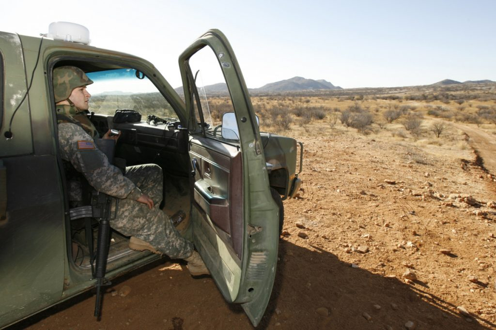 A National Guard unit patrols at the Arizona-Mexico border in Sasabe, Arizona, in 2007. National Guard contingents say they are waiting for guidance from Washington to determine what they will do following President Trump's proclamation directing deployment to fight illegal immigration and drug smuggling.
