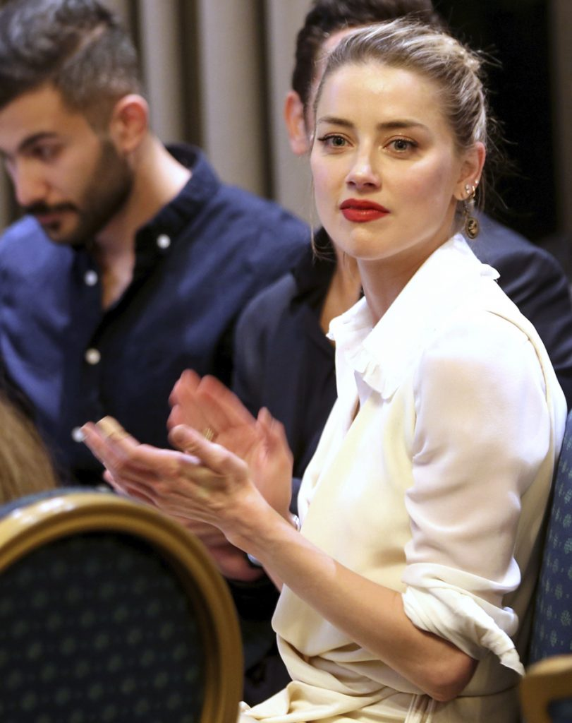 American actress Amber Heard meets with Syrian refugees and medical volunteers in Amman.