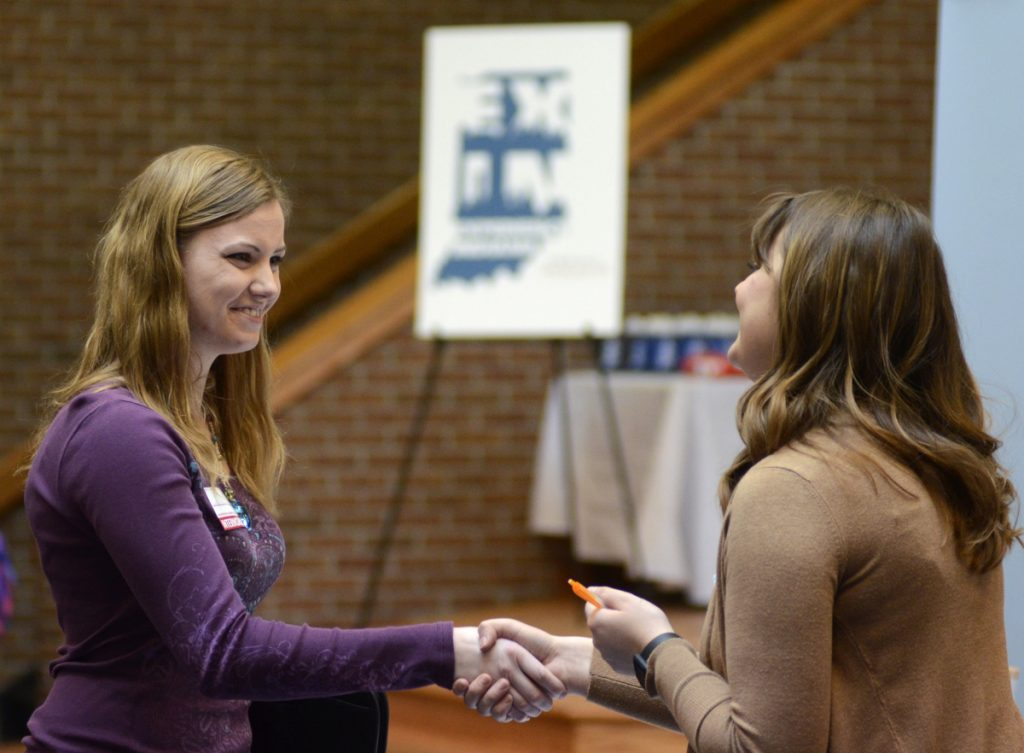 Indiana Wesleyan University senior Courtney Kingma, left, thanks Jennie Hehe, a hiring manager for Tangram, after an interview at a job fair in Marion, Ind., last month.