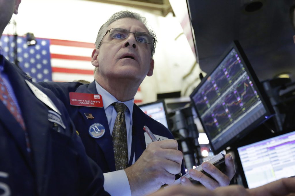 Trader Richard Deviccaro works the floor of the New York Stock Exchange. With Friday's 572-point drop, the Dow is down 10 percent from late January's record high. The S&P 500, Nasdaq and Russell 2000 indexes also lost ground Friday.