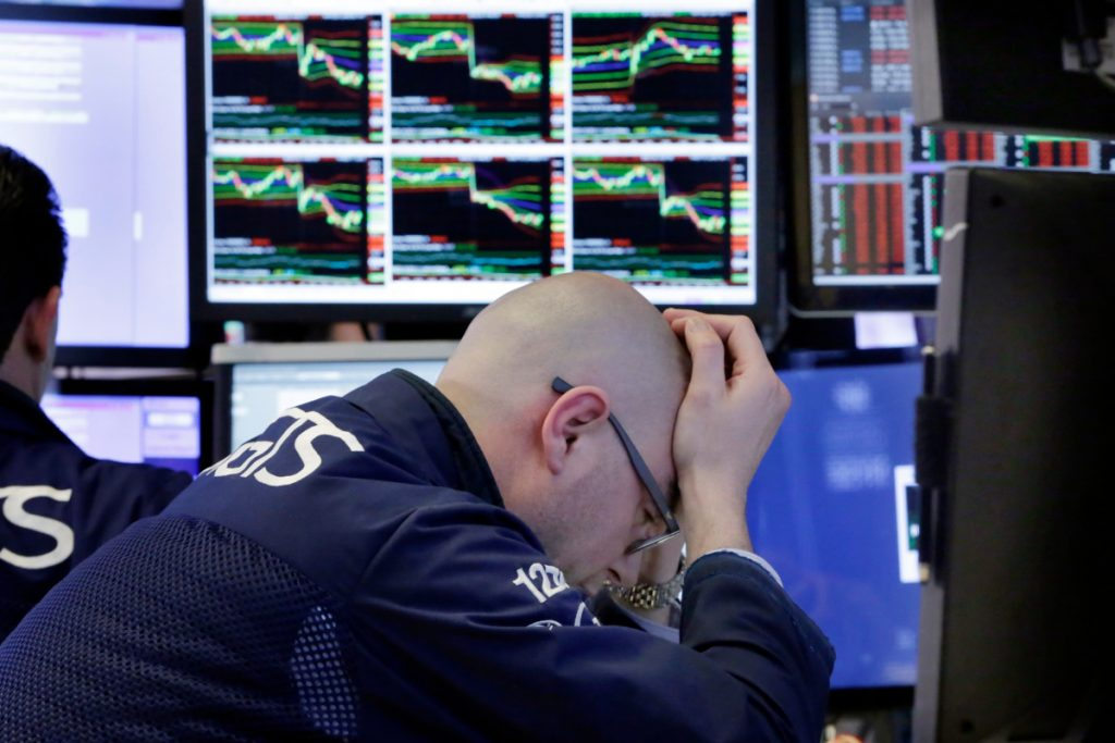 Specialist Mario Picone works at his post on the floor of the New York Stock Exchange on Friday as trade tensions with China were driving stocks down.