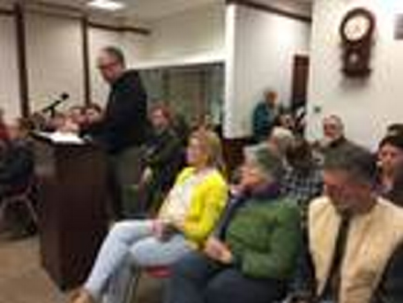 New Gloucester resident Michael Rawlings-Sekunda, at the podium, filed one of three appeals related to Day One's proposed youth residential treatment facility on Intervale Road. (Matt Junker/The Forecaster)
