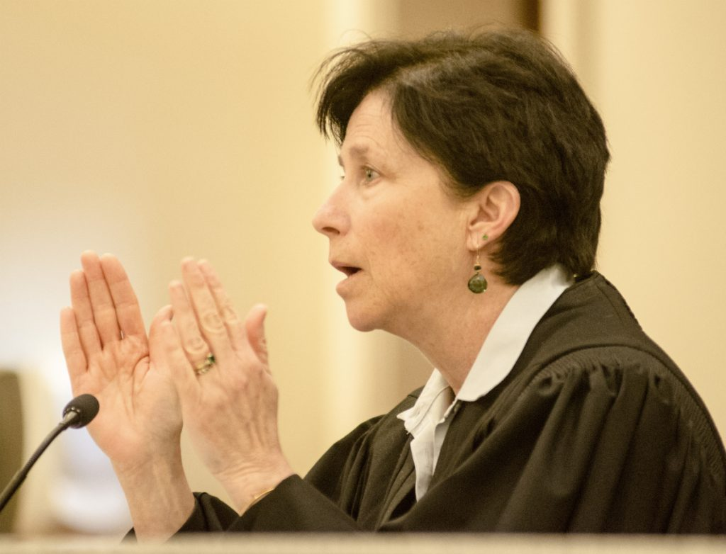 Justice Michaela Murphy ruled Tuesday that Maine's secretary of state should prepare to implement ranked-choice voting. The Maine Senate asked her Wednesday to reconsider.