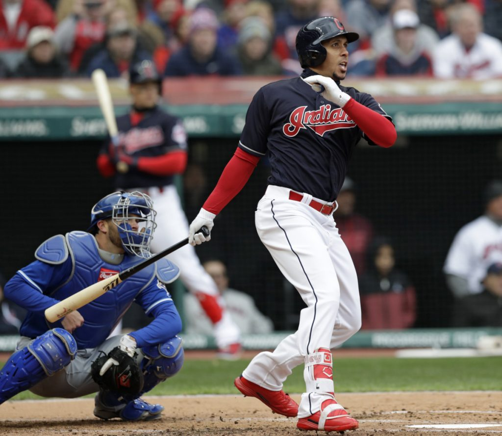 Michael Brantley of the Indians watches his two-run single in the first inning Friday against the Royals. The Indians won their home opener, 3-2.