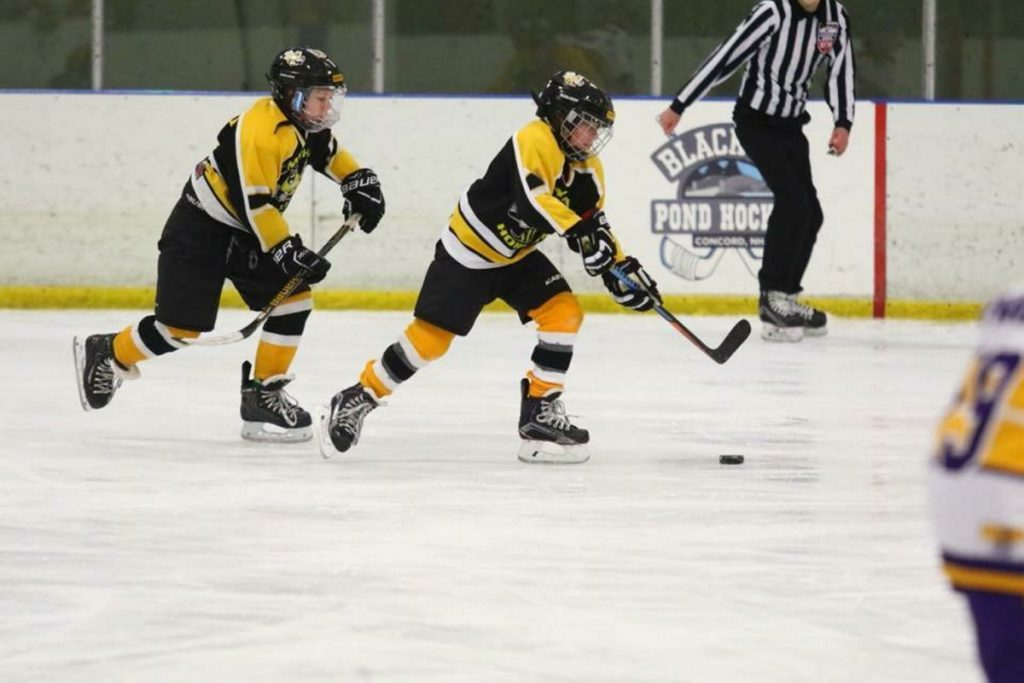 Bret Lambert, right, and Cooper Tardiff skate in a CMYHA squirt game this winter.