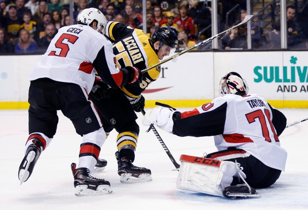 Boston's Noel Acciari tries to get a shot off against Ottawa's Daniel Taylor as Cody Ceci defends during the second period of the Bruins' 5-2 win Saturday in Boston.